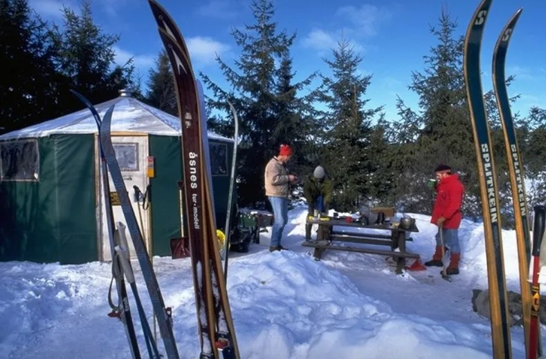 Skiers stay warm in a yurt at Algonquin Provincial Park. (Ontario Parks photo)