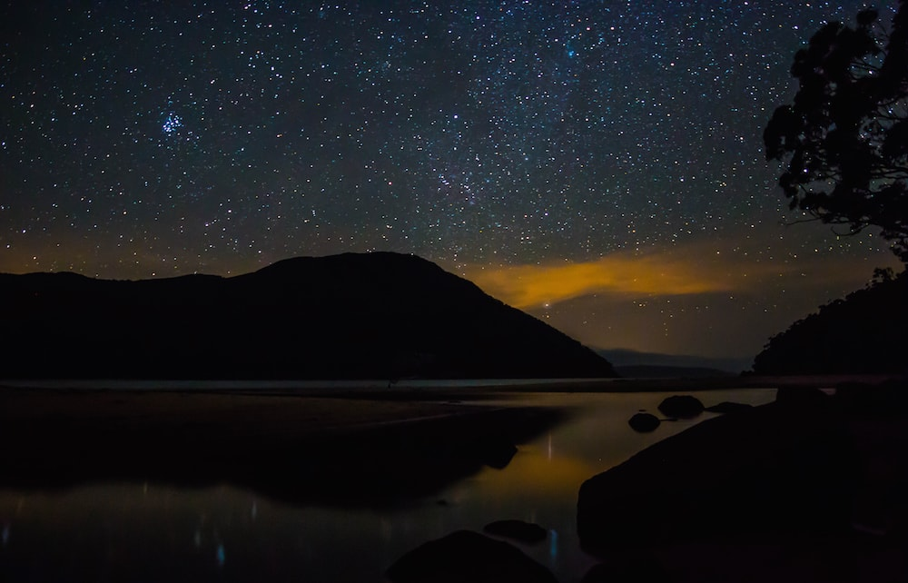 Eastern Circuit Hike // Wilsons Prom (VIC), Chris Langton, astrophotography, stars, night sky, orange, water, reflection, headland