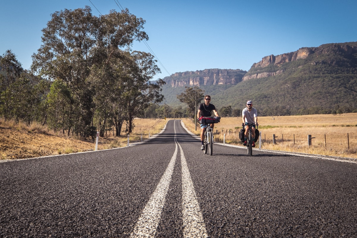 Glow Worm Tunnels Wollemi National Park NSW Reid Granite Review Henry Brydon, bike, two men, cyclists, road, white lines, trees, cliffs