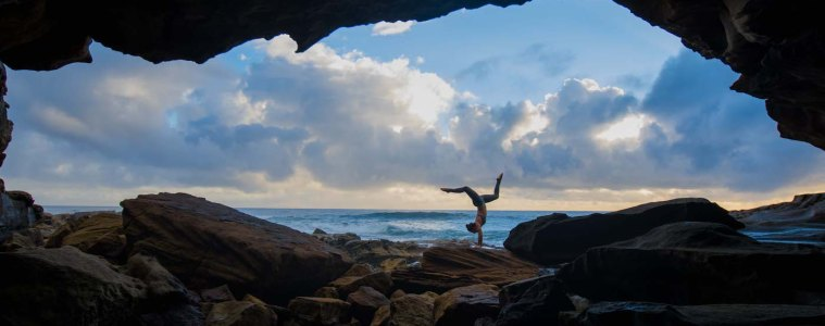 Jacquie Tapsall // Explorer Of The Month - February '18, Yuraygir NP, girl, yoga, handstand, cave, ocean, clouds, sky