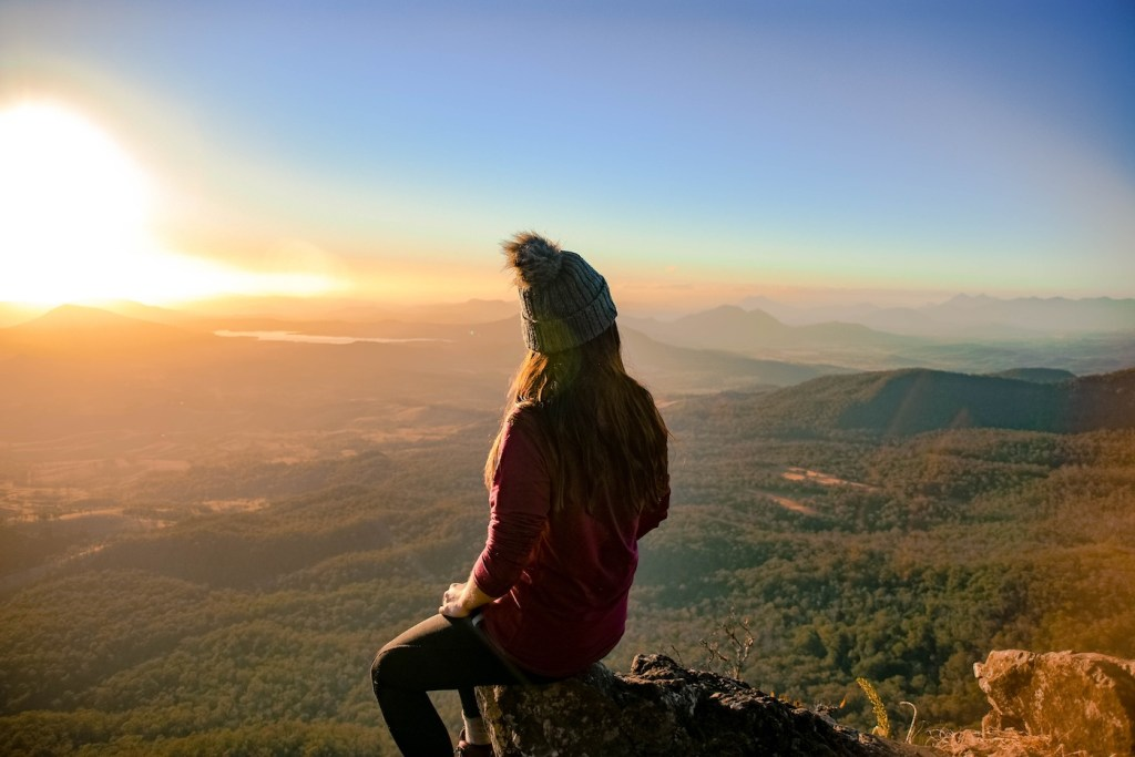 The 5 Best Sunrise Spots Near Brisbane, Lisa Owen, Mt Cordeaux, woman, bobble hat, view, lookout, valley