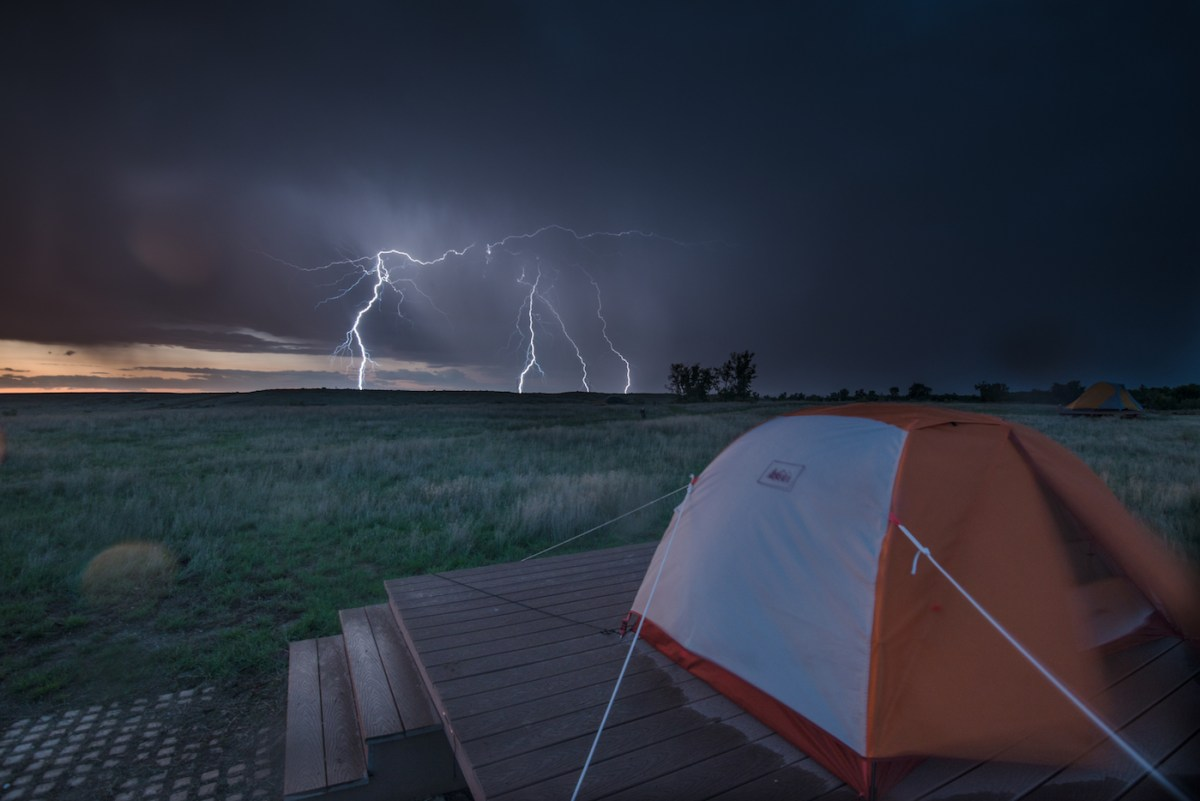 A Hiker's Guide To Lightning Safety, Xavier Anderson, photo Morgan_Cardiff, grass, storm, horizon, tent, camping platform