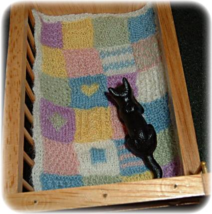 miniature knitted cot cover