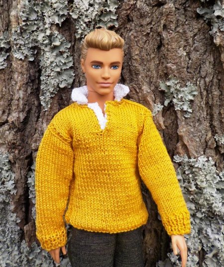 doll wearing a knitted shirt