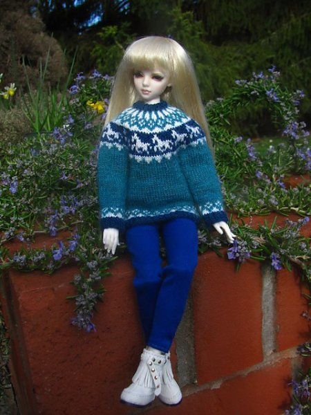 doll in knitted jumper