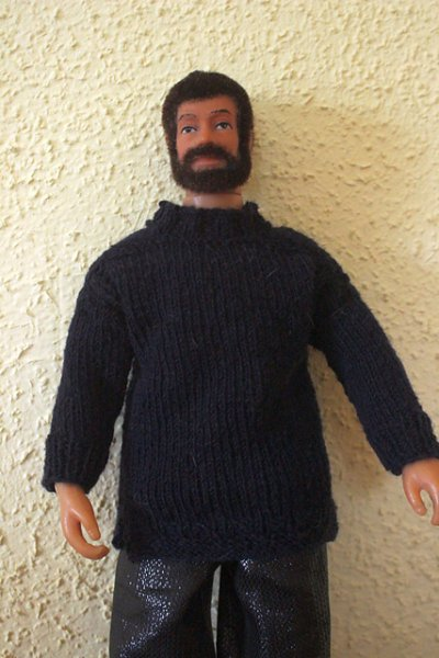 Doll wearing knitted jumper
