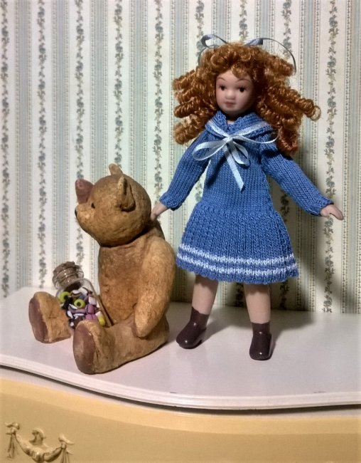 Doll in knitted dress