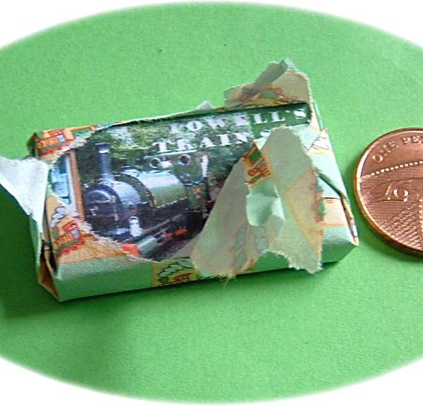 Miniature present in wrapping