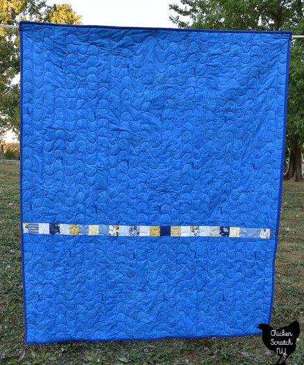 back of jelly waves blue and yellow jelly roll quilt with pieced back