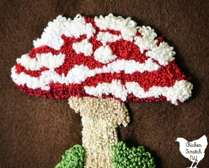 punch needle mushroom pattern with red top with white spots