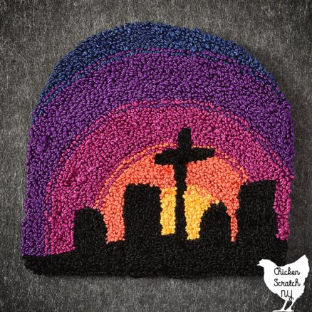 punch needle embroidery design of a sunset shifting from yellow to coral to raspberry to purple to blue behind a silhouette of graves