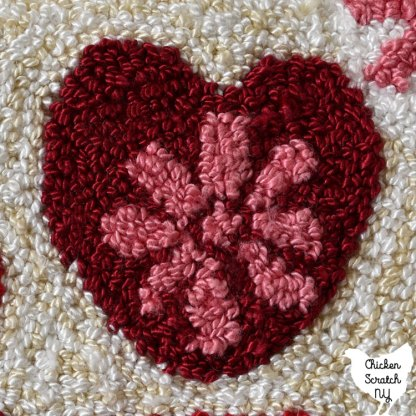 heart close up with pink 8 petaled flower