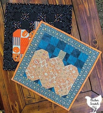 two small 16 x 16 mini pumpkin quilts