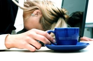 fatigue, tired woman with cup of coffee