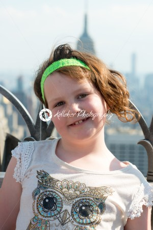 Beautiful young girl on observation deck overlooking the lower Manhattan New York City skyline - Kelleher Photography Store