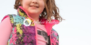 Beautiful young girl outside smiling at sunset golden hour - Kelleher Photography Store