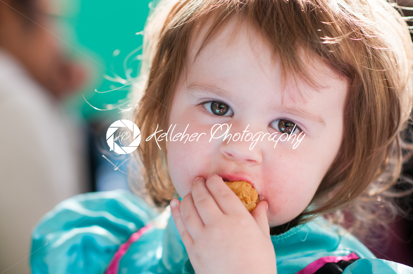 Close up Portrait of young girl eating - Kelleher Photography Store