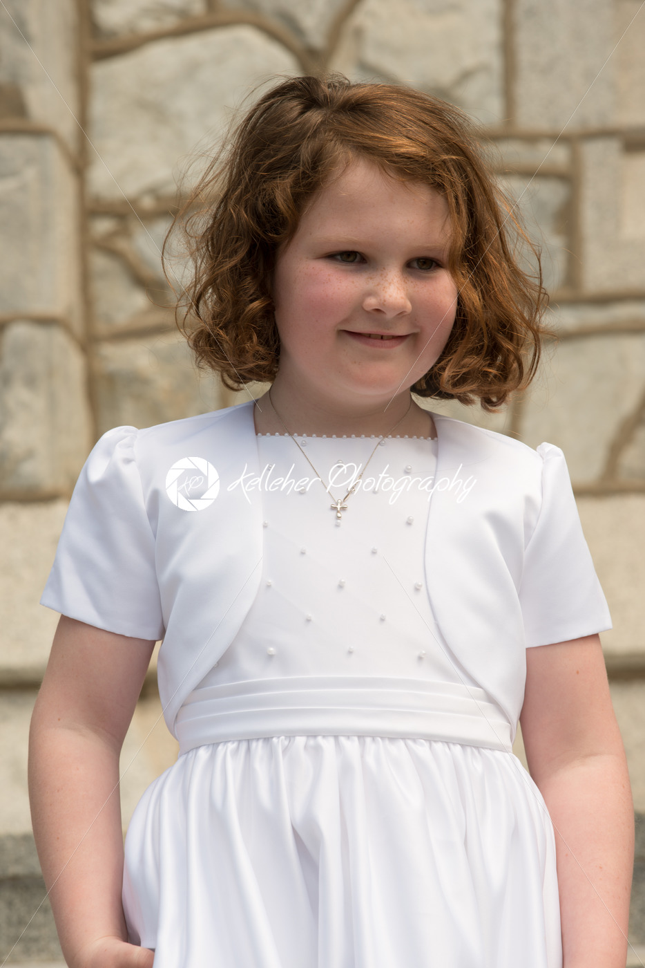 VILLANOVA, PA – MAY 14: Young Girl dressed up receiving her First Holy Communion at St. Thomas of Villanova Church - Kelleher Photography Store