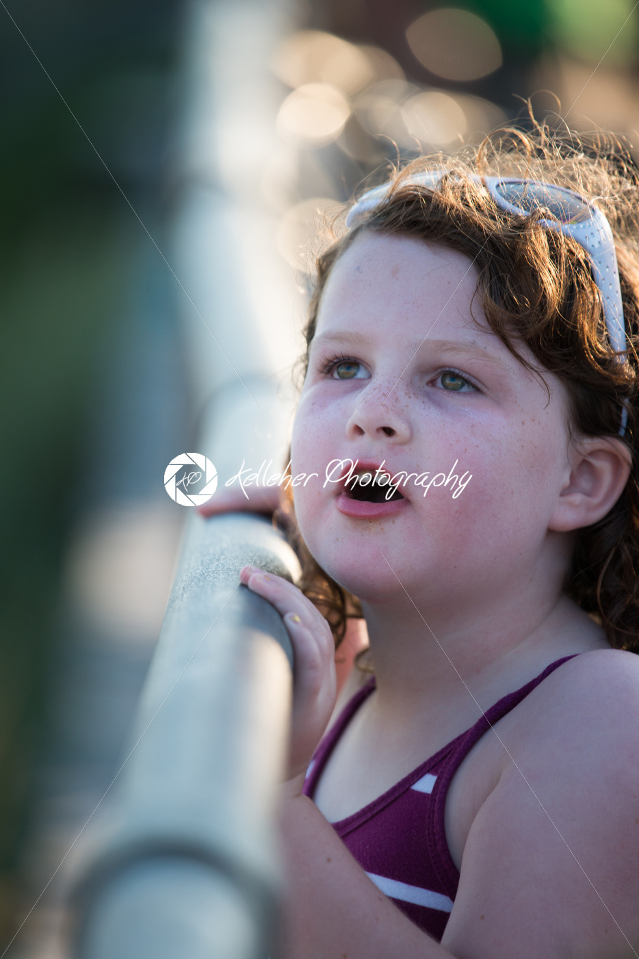 Young cute little girl on the boardwalk looking up - Kelleher Photography Store