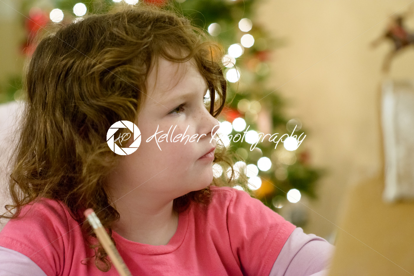 Cute little child girl writes the letter to Santa Claus near Christmas tree indoors. - Kelleher Photography Store