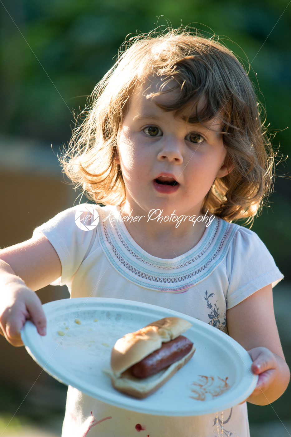Cute toddler girl eating hot dog hotdog - Kelleher Photography Store