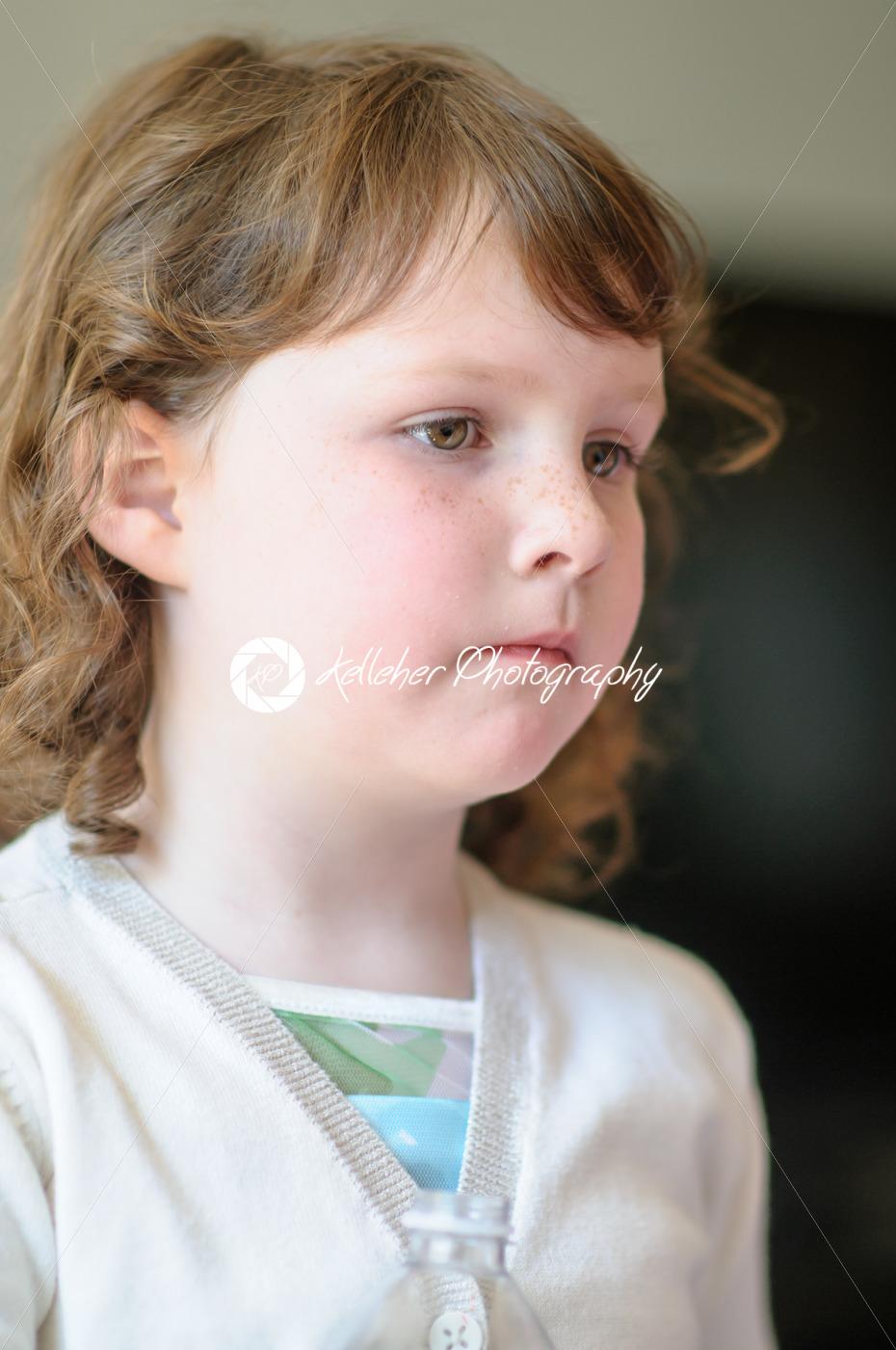 Portrait of a cute little girl inside - Kelleher Photography Store