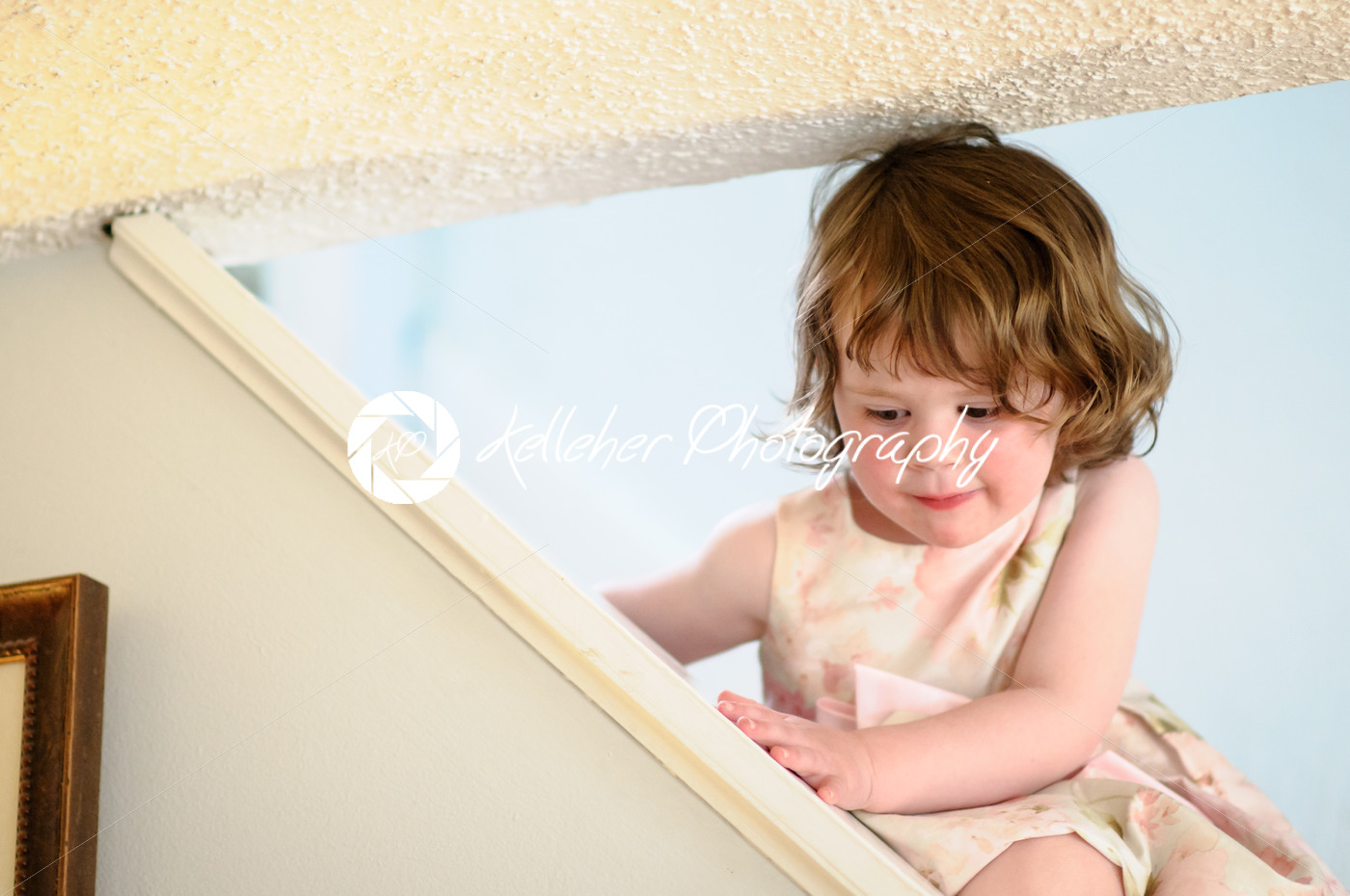 Portrait of a cute little girl inside on stairs - Kelleher Photography Store