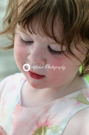 Portrait of a cute little girl smiling outside - Kelleher Photography Store