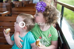 Portrait of young sibling girls riding on train - Kelleher Photography Store