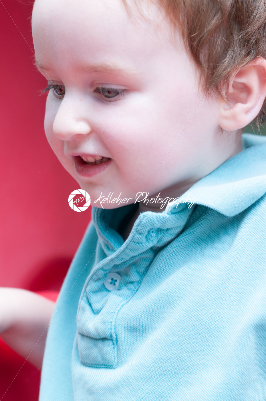 Young boy having fun outside at park on a playground swing set - Kelleher Photography Store