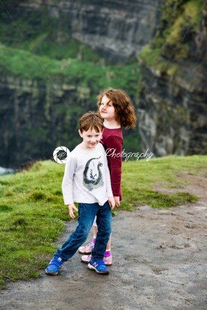Boy and Girl walking up the Cliffs of Moher Tourist Attraction in Ireland - Kelleher Photography Store