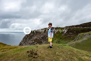 Boy looking out over Slieve League Cliffs, County Donegal, Ireland - Kelleher Photography Store