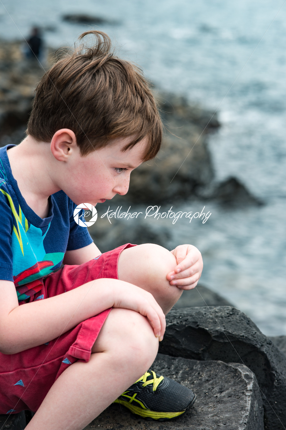 Boy sitting on the rocks at Giant's Causeway - Kelleher Photography Store