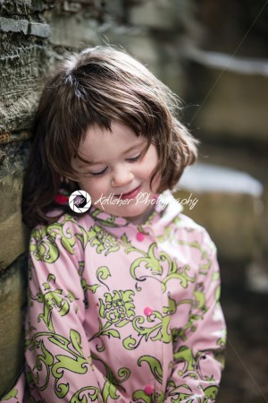 Young little girl portrait looking and smiling at the camera. - Kelleher Photography Store