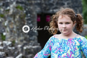 Young little girl portrait looking at the camera with Aughnanure castle in background - Kelleher Photography Store
