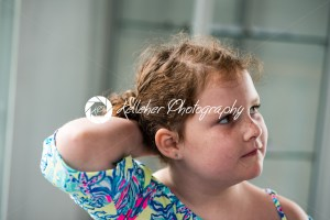 Young little girl portrait looking out window - Kelleher Photography Store