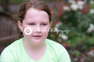 Close-up portrait of a cute redhead girl thinking - Kelleher Photography Store