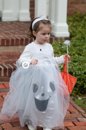 Little girl in witch costume having fun at Halloween trick or treat - Kelleher Photography Store