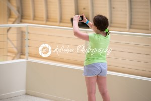 Young girl taking photographs at a museum - Kelleher Photography Store