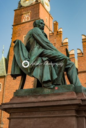 Wroclaw, Poland – March 4, 2018: Neoclassical bronze statue of famous Polish writer Alexander Fredro, 1897, by Leonard Marconi in warm sunlight in Market Square - Kelleher Photography Store