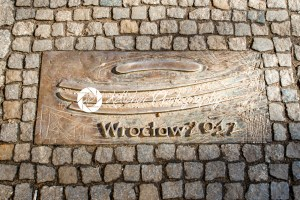 Wroclaw, Poland – March 9, 2018: One of the metal plaques on Wroclaw's Sidewalk Timeline commemorating influential dates - Kelleher Photography Store