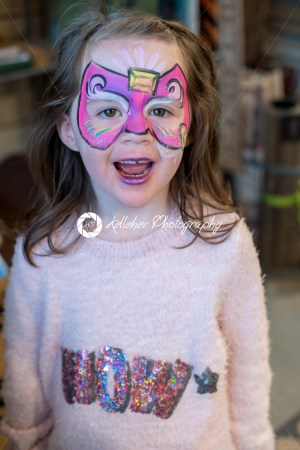 Pretty excited cute young girl with face painting like a butterfly - Kelleher Photography Store