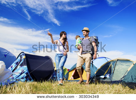 stock-photo-beautiful-young-family-at-summer-music-festival-303034349