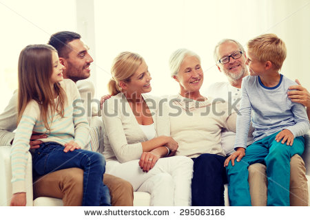 stock-photo-family-happiness-generation-and-people-concept-happy-family-sitting-on-couch-at-home-295063166