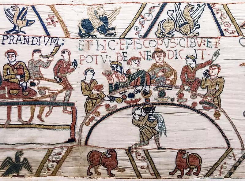 800px-Bayeux_Tapestry_scene43_banquet