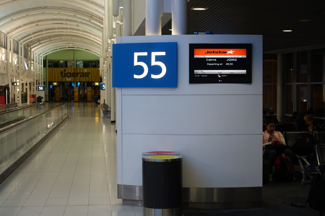 Gate 55 with the flight information screen