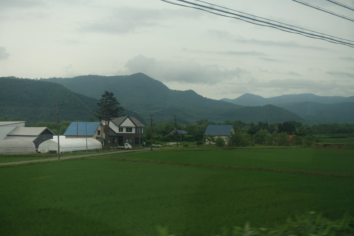 Farm houses in front of mountains