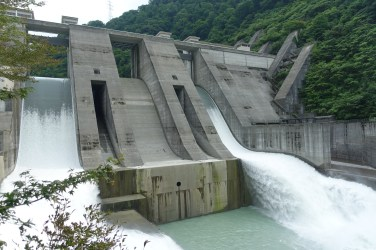 Water spilling out of a dam