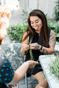 Jewell Gillies demonstrating how to braid a large sweetgrass