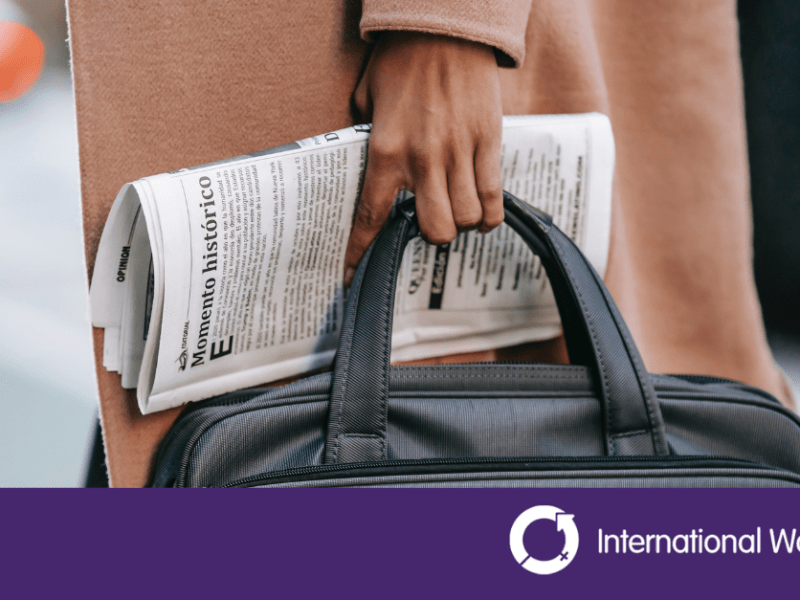 Person holding briefcase with Intenrational women's day logo